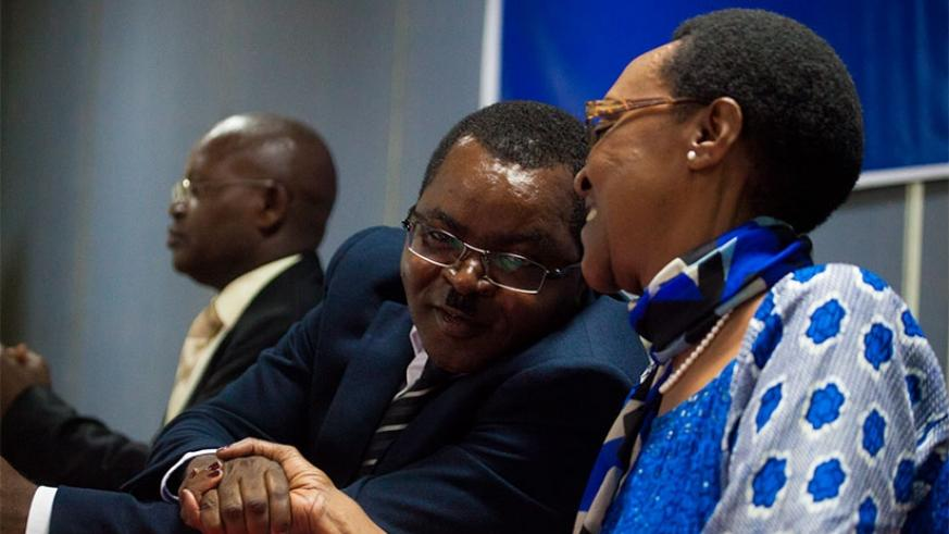 Munyeshaka (L) and Ingabire exchange greetings during the launch of the report in Kigali yesterday. (Photos by Timothy Kisambira)
