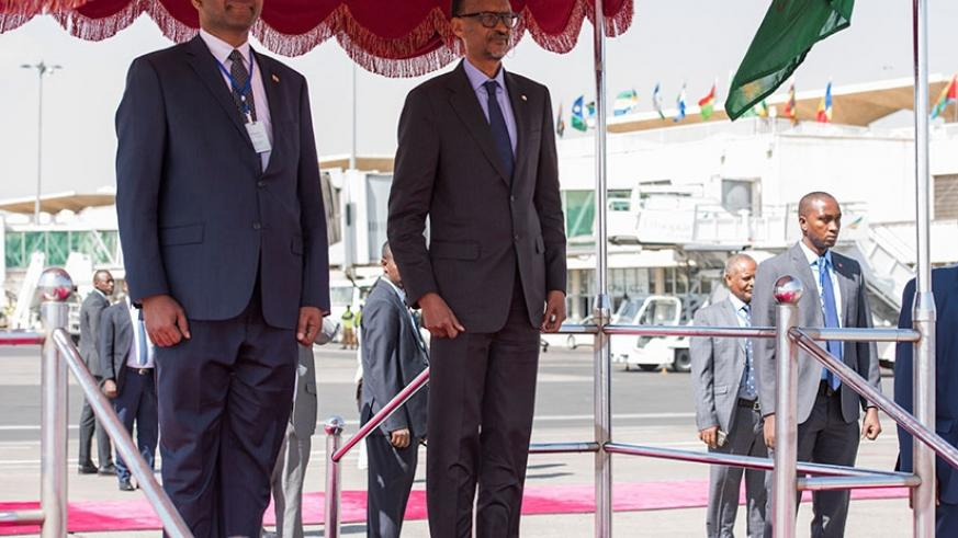 President Kagame and Ethiopia's Minister for Public Service and Human Resource Development Tagesse Chafo listen to the national anthem yesterday shortly after the President and Fir....