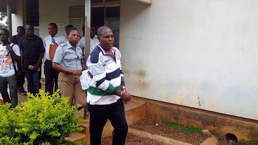 Genocide suspect Vincent Murekezi leaves a court in Malawi during a previous appearance. / File