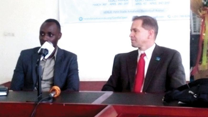 Rwanda Taekwondo Federation Secretary General Placide Bagabo (L) and Martin Koonce; the technical director during the press conference at Amahoro satdium on Tuesday (Geoffrey Asiimwe)