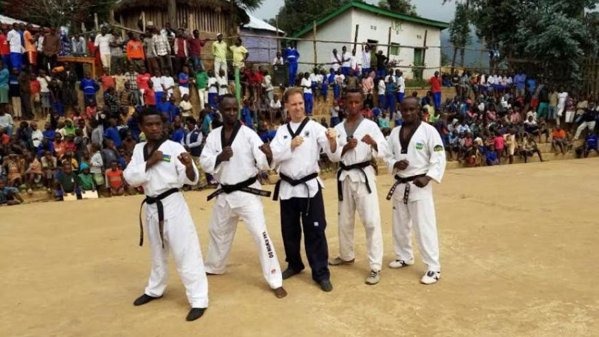 Officials of Rwanda Taekwondo Federation demostrating for refugees in Kiziba Camp. / Courtesy