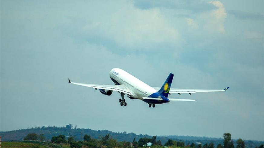 A RwandAir plane after takeoff at Kigali International Airport. The airline has opened another channel for travellers to book and pay for flights online. / File