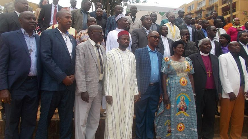 Dr Anicet Nzabonimpa, in charge of reproductive, maternal and child health at RBC, in a group photo with religious leaders. Elias Hakizimana.