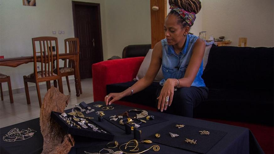 A Rwandan designer, Sarafina Legrand, displays  an assortment of her jewelry in Kigali. Faustin Niyigena.