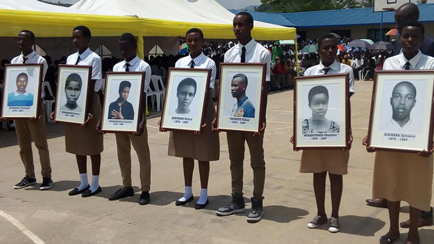 Students display photos of the victims (Steven-Muvunyi)