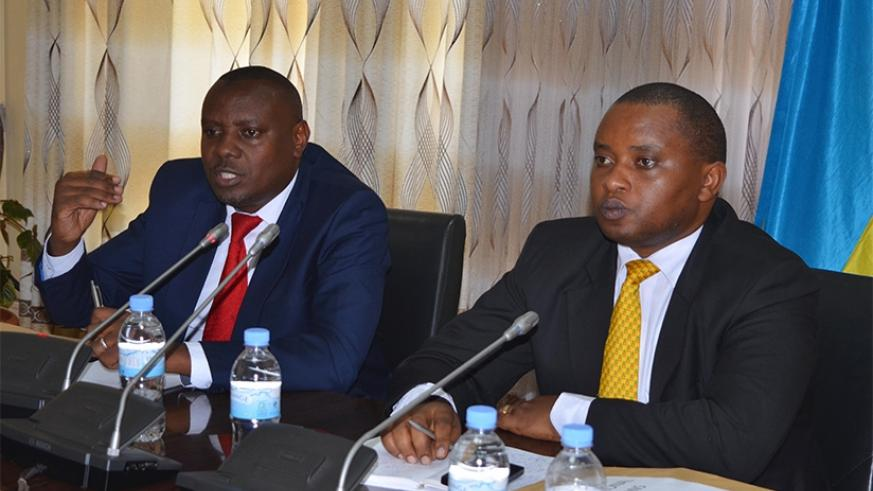 State Minister for Primary and Secondary Education Isaac Munyakazi (L) and State Minister in charge of TVET Olivier Rwamukwaya address journalists while announcing results of the 2....