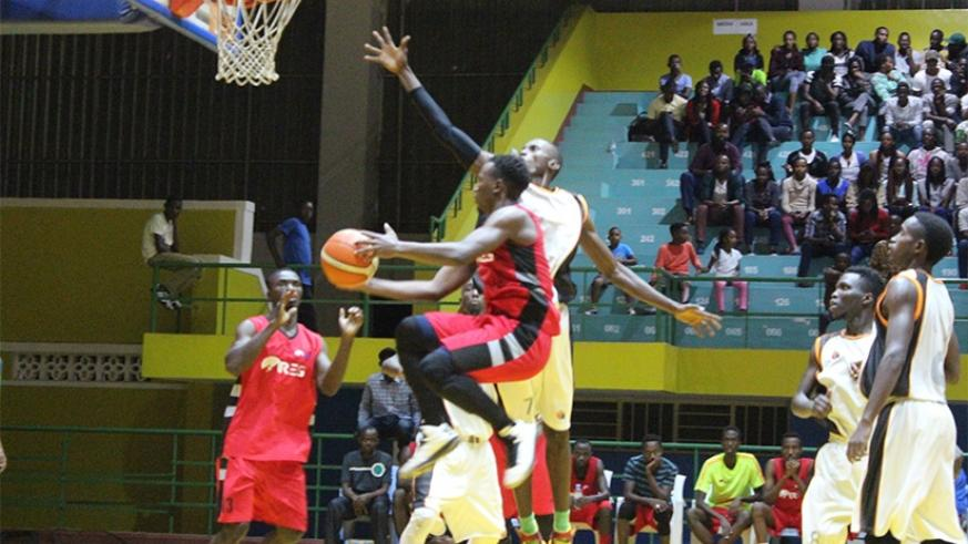 REG shooting guard Benjamin Mukengerwa tries to drop a point as APR players try to block him. He scored the game's high 17 points. (Geoffrey Asiimwe)