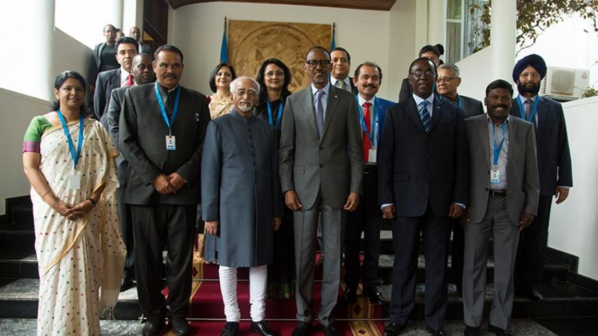 President Kagame and the delegation of Indian government and private sector officials led by VP Ansari (3rdL) in a group photo at Village Urugwiro yesterday.