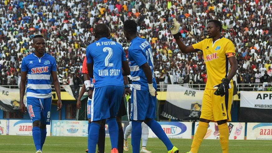 Rayon captain Ndayishimiye intervenes after one of his teammates is shown a yellow card during their league match against APR recently Sam Ngendahimana