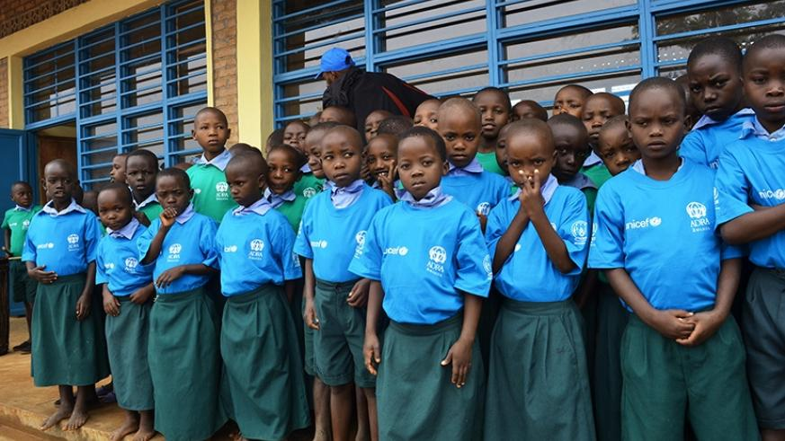 Burundian refugee children pose in front of their newly built classrooms near Mahama camp. Sam Ngendahimana.