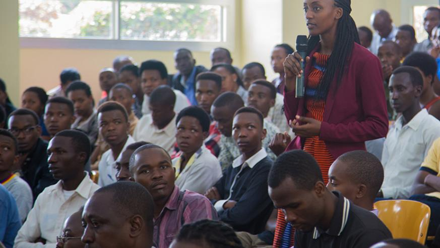 Fourth year student at sciences and tech faculty college, Raissa Mugisha asks the Indian vice president a question yesterday. Faustin Niyigena
