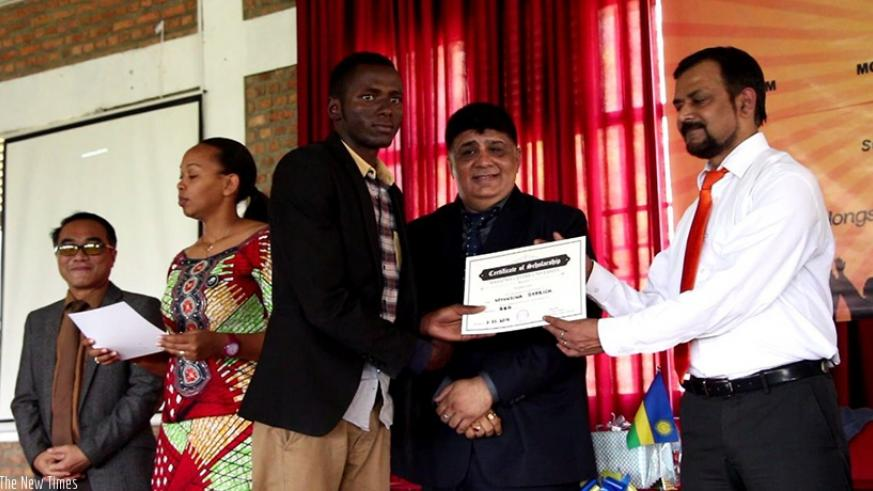 One of the students awarded scholarships by Mahatma Gandhi University receives his certificate.