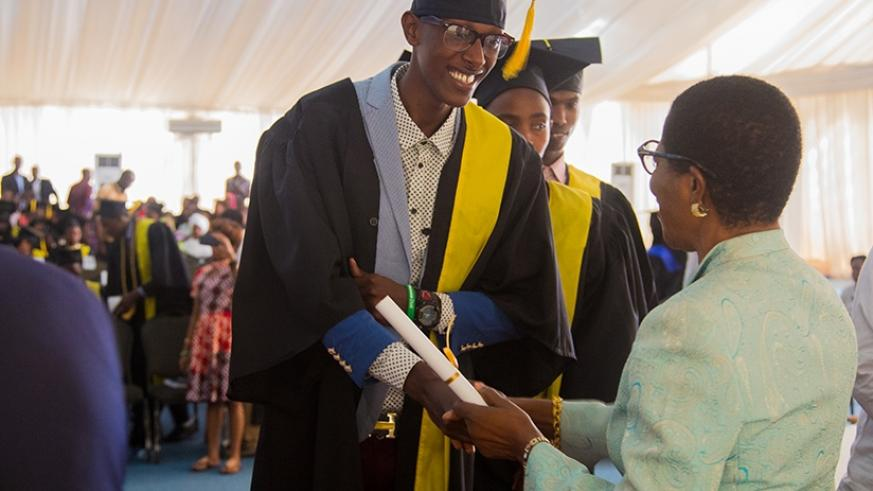 Esther's Aid students receive certificates on their graduation. Faustin Niyigena.