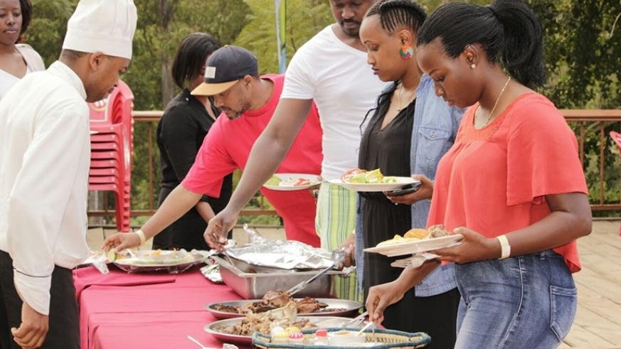 People queuing up for Mutzig Lite Barbecue at Kigali Golf Club. / Courtesy