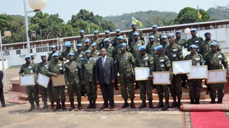 President Touadera in a group photo with the decorated RDF peacekeepers. Courtesy