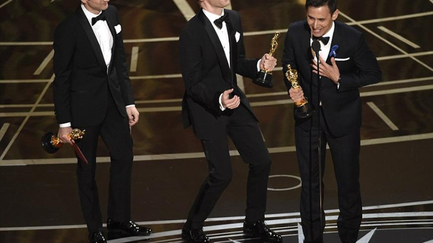 La La Land swept the original music categories as Justin Hurwitz, Justin Paul, and Benj Pasek pictured from left to right accepted gongs. Net