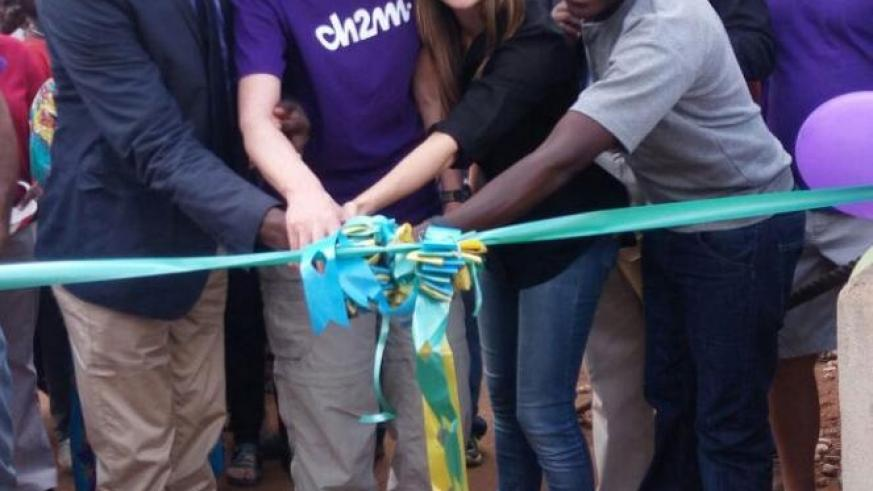 Antoine Bisizi (L), Brooke Sergeberg (2nd Right) and other officials cut a ribbon at the launch of the bridge. John Mbaraga. File.