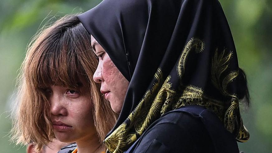 Doan Thi Huong (left) and Siti Aisyah arriving at court. The pair were made to wear bulletproof vests as they left. Photograph: Mohd Rasfan/AFP/Getty Images