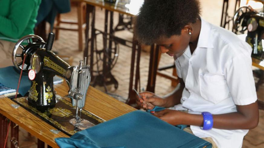 A student learns tailoring. Learning a new skill in the vacation will make you more competitive on the job market. / File