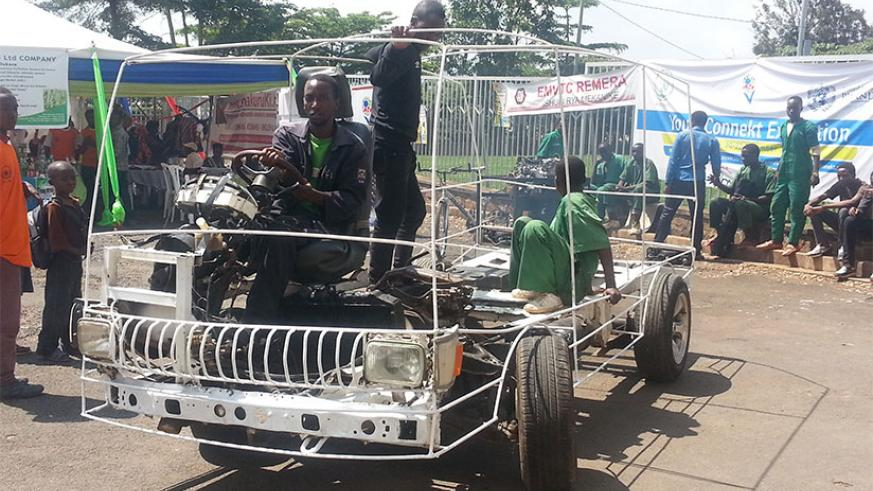 Eric Hakizimana test-drives one of the prototype cars assembled by EMVTC students. / Elisee Mpirwa