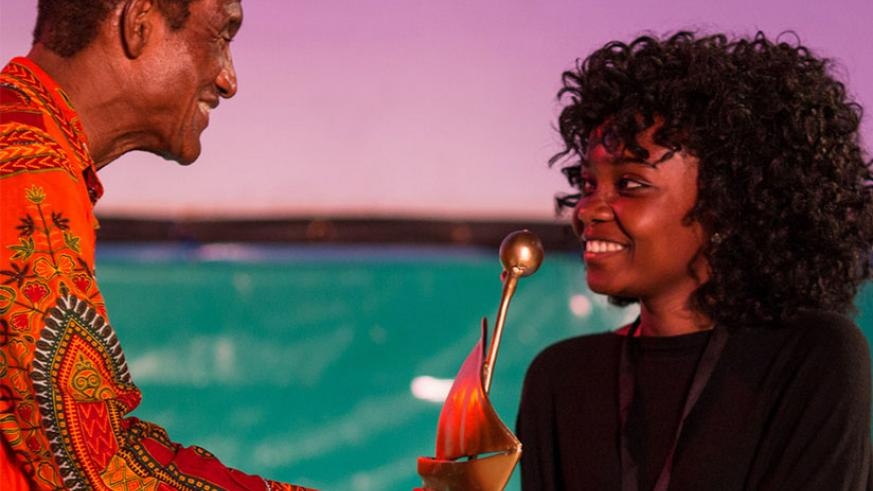 Dusabejambo receives her previous award at the Zanzibar International Film Festival in 2016. / Internet photo