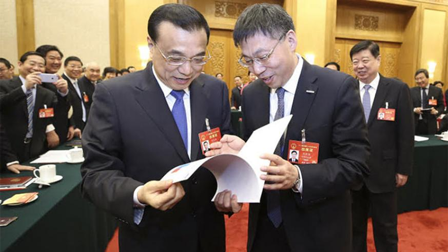 China's Premier Li Keqiang (left) and another official at the function. / Richard Ruhimbana