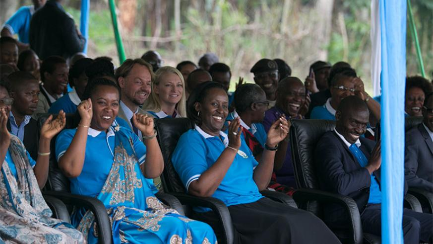 The First Lady, Mrs Jeannette Kagame, Gender and Family Promotion minister Esperance Nyirasafari (left) and the Mayor of Nyabihu District, Theoneste Uwanzwenuwe (R), cheer a perfor....