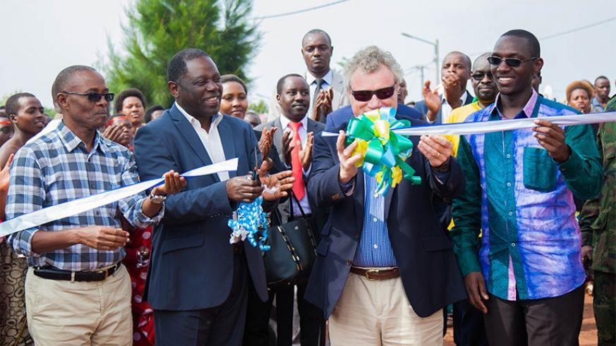 Fulgence Nsengiyumva, the State Minister for Agriculture (2ndL); Michael Ryan, the head of the EU Delegation to Rwanda (2nd R); and the Mayor of Rulindo District, Emmanuel Kayirang....