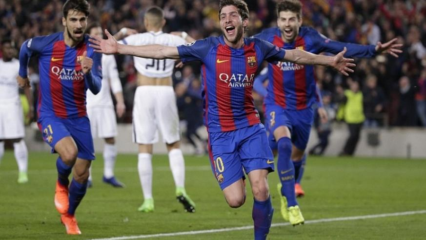 Roberto is chased by team-mates Andre Gomes and Gerard Pique as they rejoice in a miracle win at the Nou Camp. Net photo