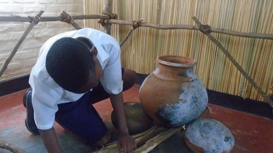 A pupil demonstrates how food was prepared in the past. / Lydia Atieno