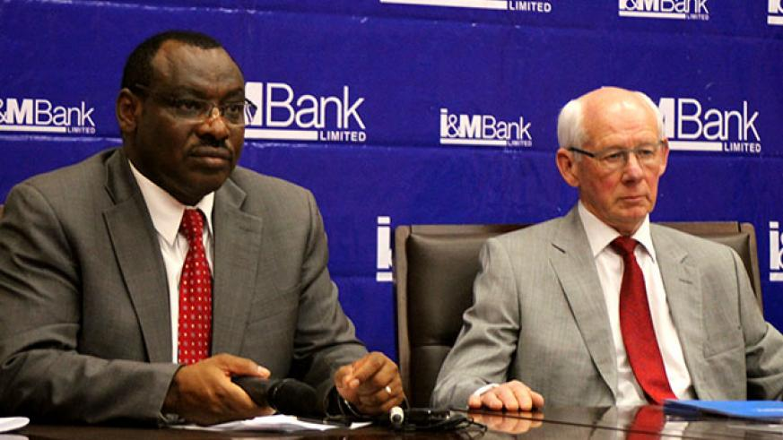 Finance Minister Claver Gatete and I&M Bank Rwanda's board chairman Bill Irwin give explanations at the launch of the sale of the State's shares in the bank on 14th February.