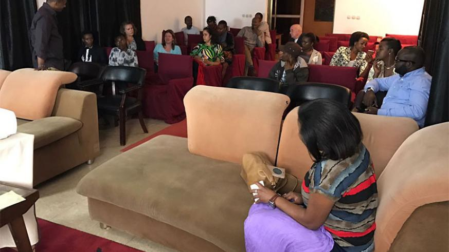 The audience at Wednesday's film screening engage in a question-and-answer session. Left: Eric Kabera, the founder and director of Kwetu Film Festival. Courtesy photos
