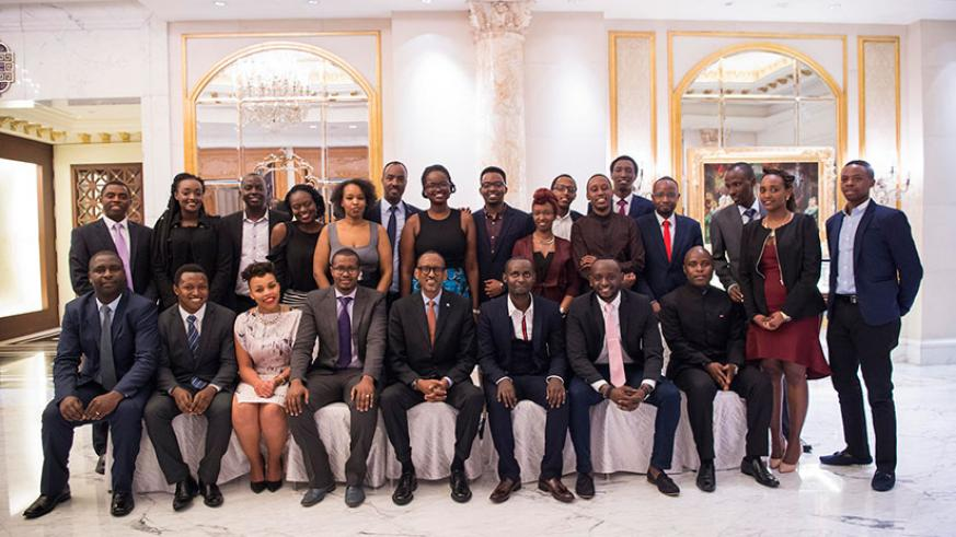 President Kagame with Rwandan students in China. In the background is Rwanda's Ambassador to China, Charles Kayonga. As part of his meeting with students, Kagame also met with memb....