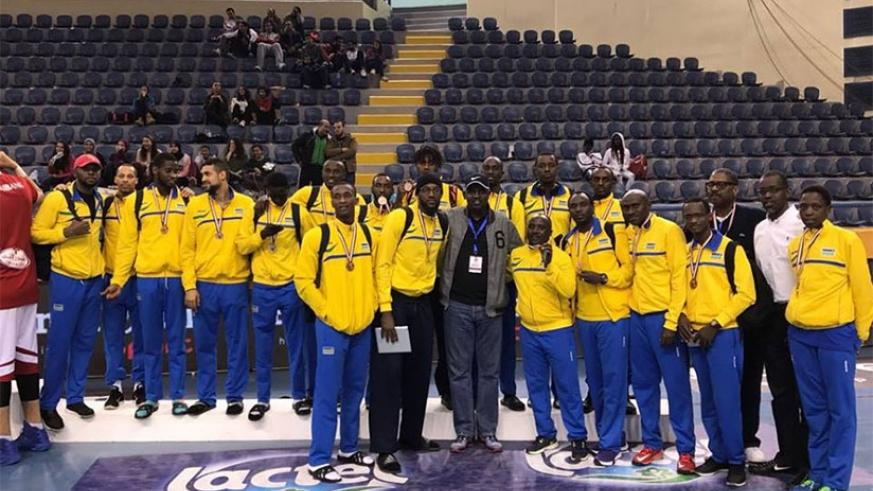 Rwannda national basketball team pose with their bronze medals after defeating Burundi 89-75 in the third place play-off on Saturday. Courtsey.