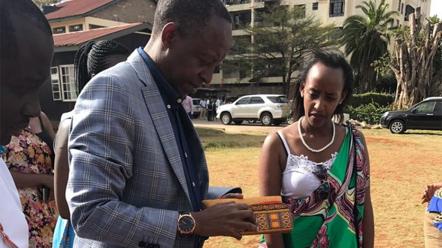 Amb. Kimonyo inspects some of the products exhibited during the fete. Courtesy.