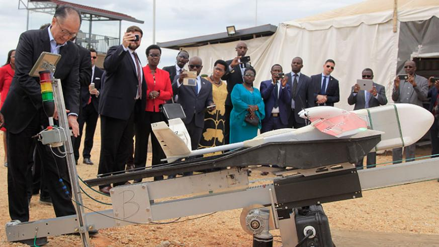 World Bank Group president Jim Yong Kim launches a medical supply delivery drone at Zipline Drone Project in Muhanga District yesterday. Kim, who is in the country on a two-day vis....