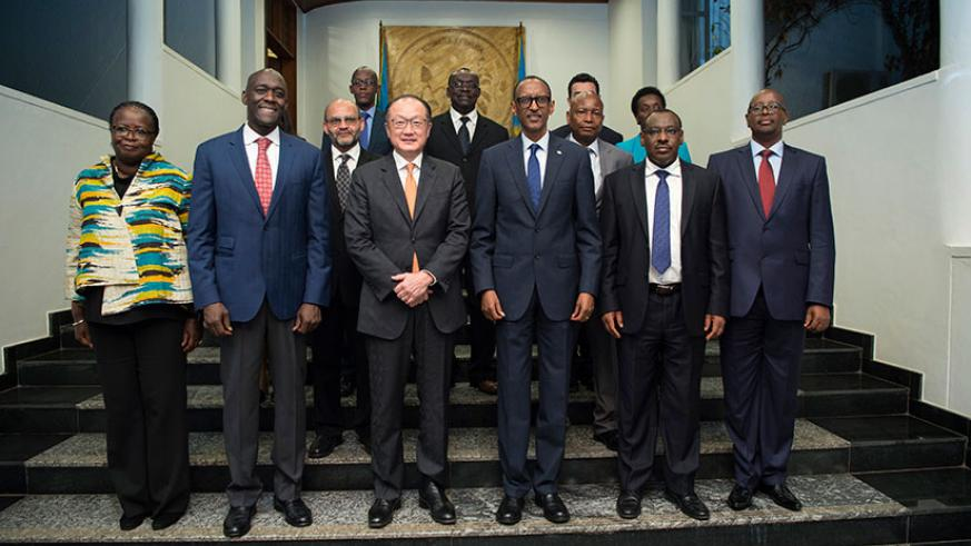 President Kagame with World Bank head Jim Yong Kim (on his right), Makhtar Sop Diop, the Bank's vice-president for Africa (second-left), Finance and Economic Planning minister Clav....