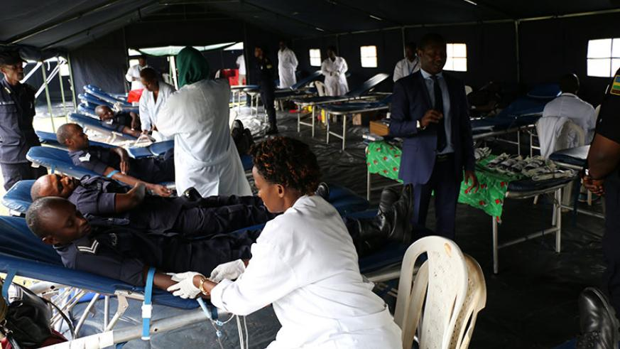 Police officers donating blood. / Courtesy