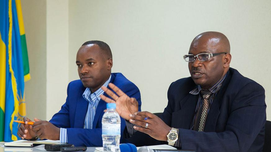 Celestin Sibomana, Director of Capacity Development in RPPA (R), and Richard Migambi speaks during the press conference in Kigali. / Nadege Imbabazi