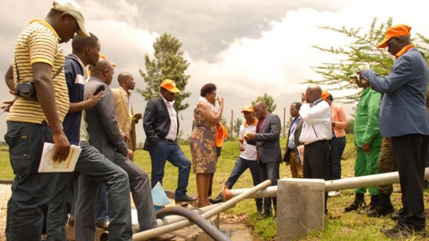 Officials visit the plant's water tank in Gatsibo District recently. (Kelly Rwamapera)