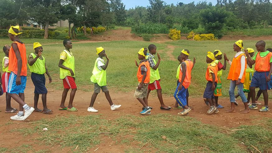 Pupils of GS Mwendo in Nyarugenge, Kigali, participate in a football tournament organised to promote equality of rights .   (All photos by Francis Byaruhanga)