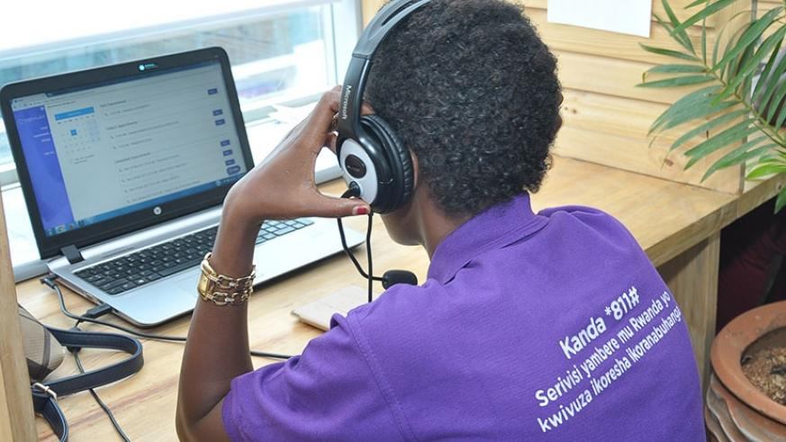 A call centre operator speaks to a patient at Babyl offices. (Steven Muvunyi)