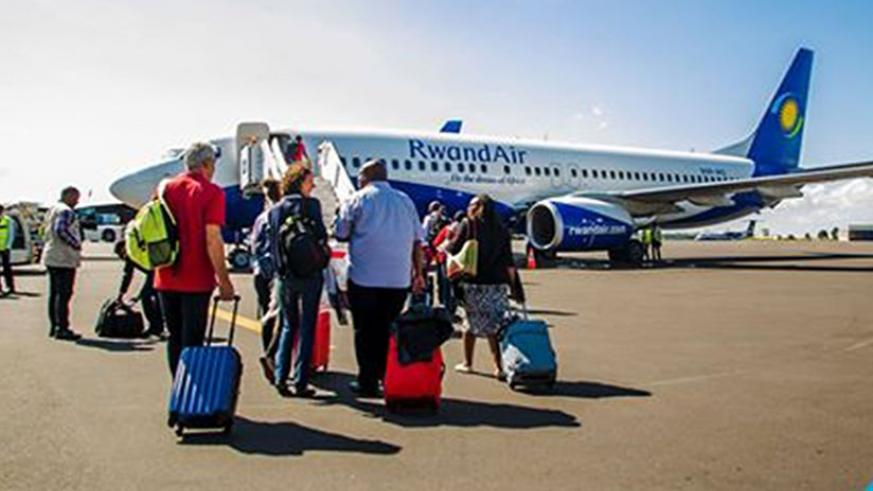 Harare-bound passengers board RwandAir's  Kalisimbi  yesterday. The airline will ply the route four times a week via Lusaka, Zambia. (Courtesy)