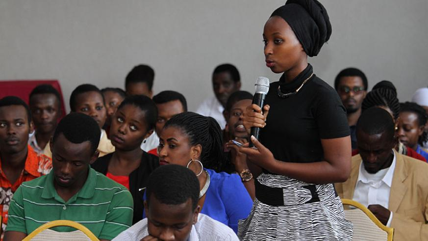A participant poses a question during the annual youth conference in Kigali. / Courtesy