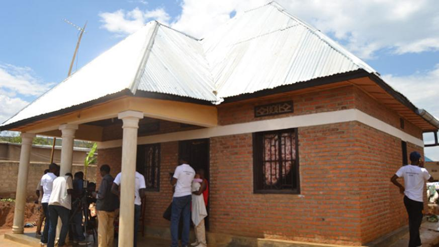 A house built by young Genocide survivors and handed to Donatille Mukakayonde, a survivor. / Jean d'Amour Mbonyinshuti