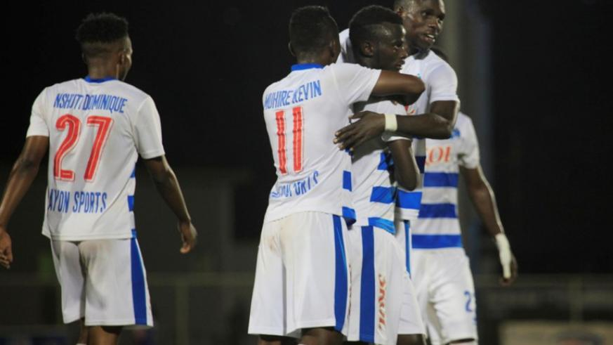 Rayon Sports' Djabel Manishimwe (c) celebrates with his teammates after he scores the fourth goal. All photos by Sam Ngendahimana.