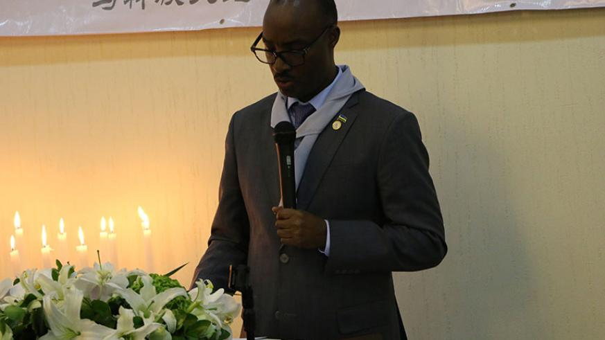 Lt. Gen. Charles Kayonga addressing mourners in China. (Courtesy photos)