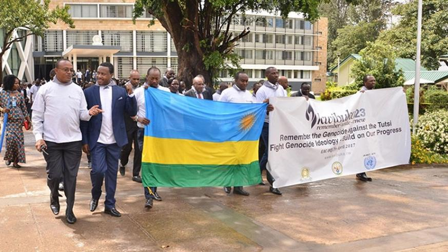 Rwandans and friends of Rwanda in Tanzania during the Walk to Remember in Tanzania, yesterday. Courtesy.
