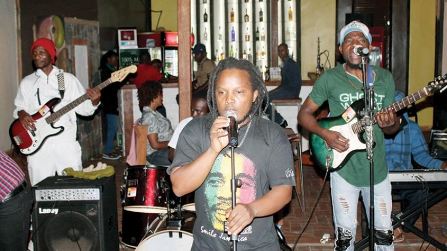 2T Reggae Man on stage with his backing band. Courtesy photos..