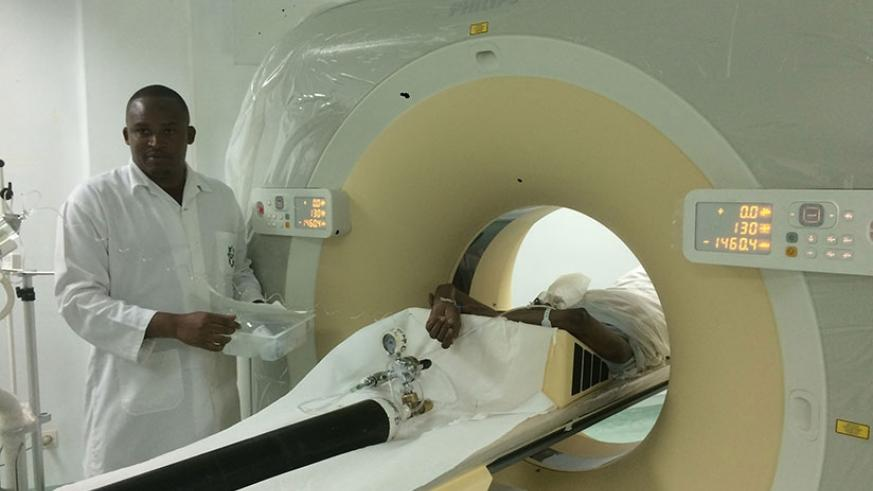 A medic uses a CT Scan on a patient at King Faisal Hospital. (File)